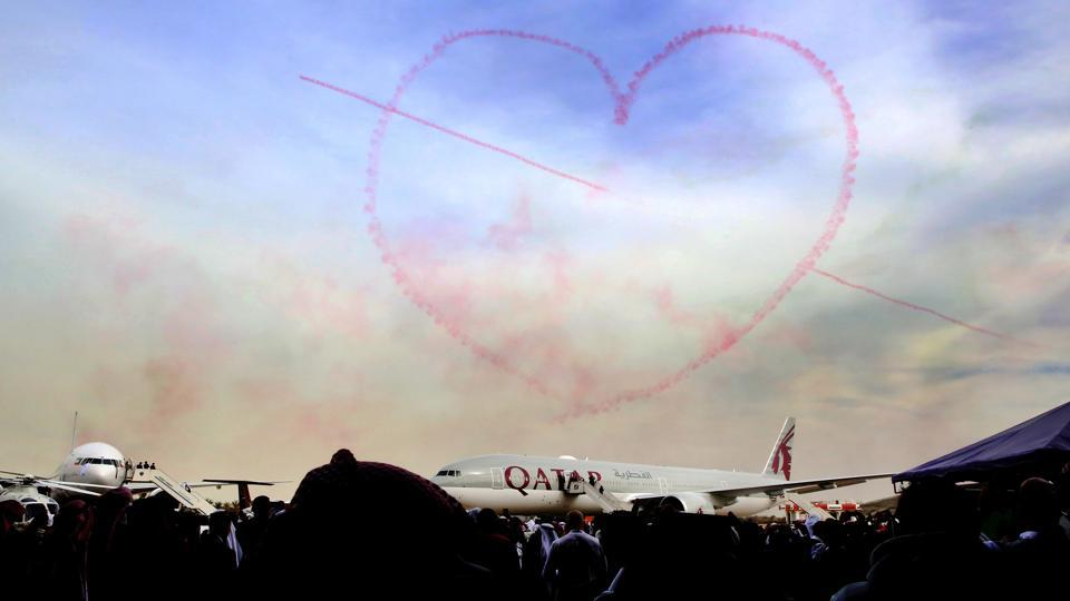 A smoky heart takes shape in the sky above a Qatar Airways plane during the Kuwait aviation show in Kuwait City on January 17. (Yasser Al-Zayyat / AFP)