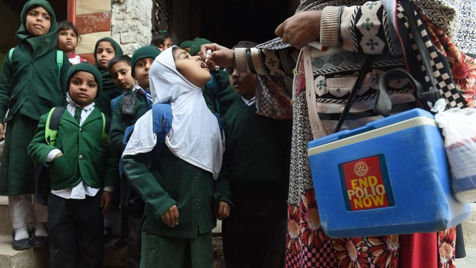 A Pakistani health worker administers polio vaccine drops to school children during a polio campaign in Lahore on January 15. Pakistan is one of only two countries in the world where polio remains endemic. (Arif Ali / AFP)