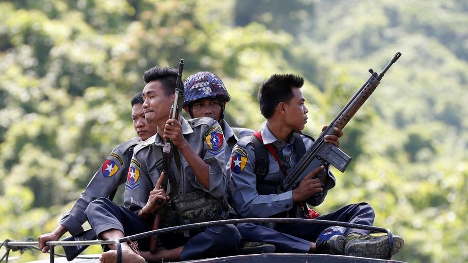 File photo of Myanmar police guarding a UN convoy.