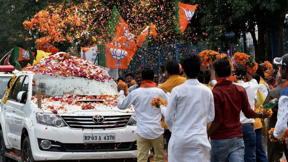 Supporters welcome BJP national president Amit Shah in Bhopal on August 18, 2017.