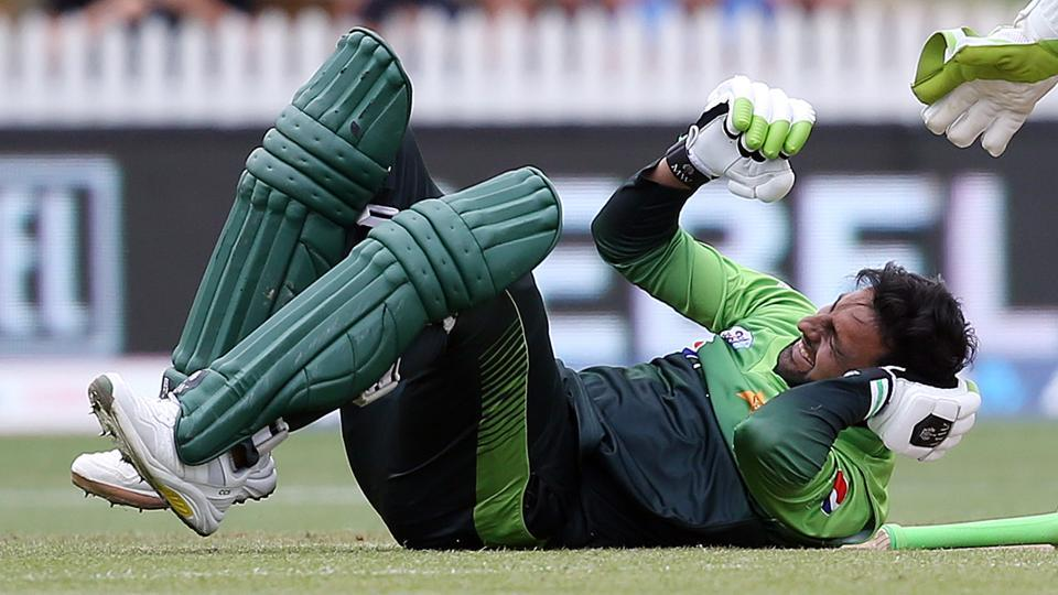 Pakistan's Shoaib Malik falls to the ground after being hit in the head during the ODI match against New Zealand.