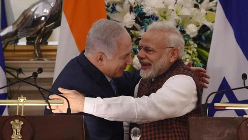 Indian Prime Minister Narendra Modi (R) hugs Israeli Prime Minister Benjamin Netanyahu during a press conference at Hyderabad House in New Delhi on January 15, 2018.