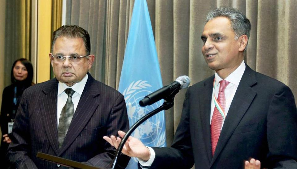Syed Akbaruddin , India's Permanent Representative to the United Nations, speaks during a reception in the honour of Justice Dalveer Bhandari (L) at the United Nations in New ---- after Bhandari made it to the International Court of Justice.
