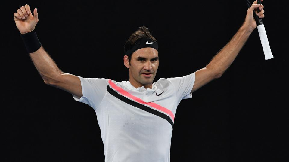 Roger Federer celebrates after victory in his Australian Open third round match against Richard Gasquet. (AFP)