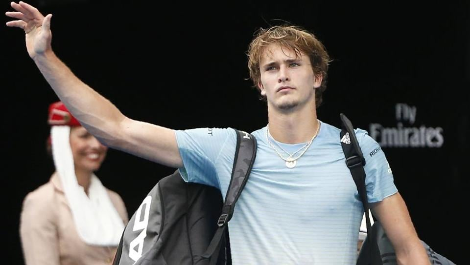 Alexander Zverev of Germany waves as he leaves after losing against Chung Hyeon of South Korea at the Australian Open on Saturday.