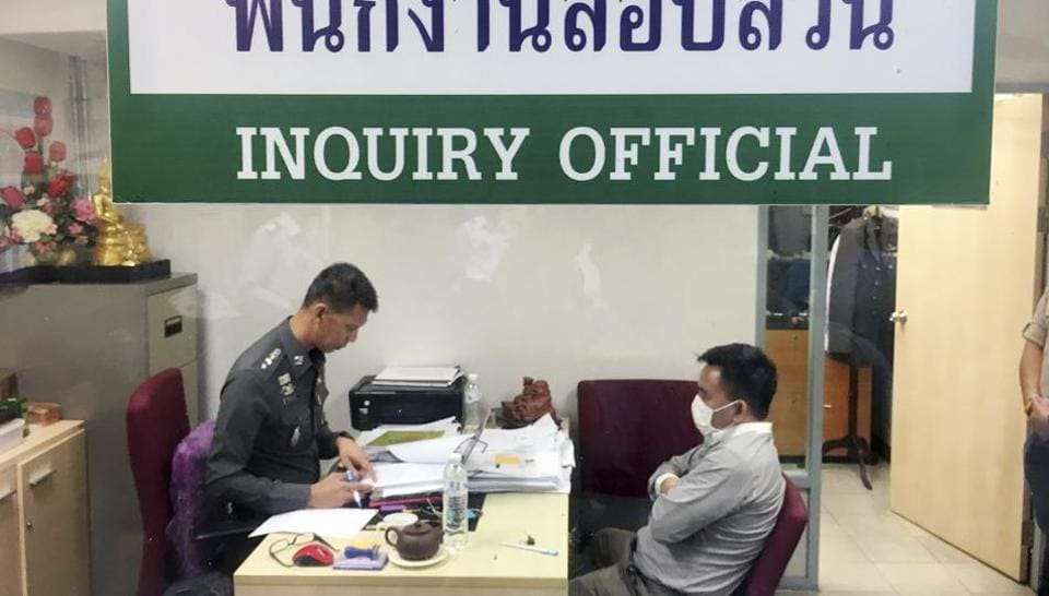Police process suspected wildlife trafficker Boonchai Bach, right, a 40-year-old Thai of Vietnamese descent, Saturday, Jan. 20, 2018, in Bangkok, Thailand.