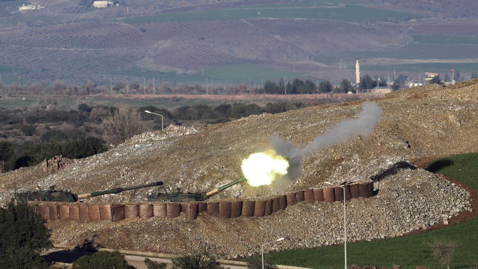 In this photo taken Friday, Jan 19, 2018, Turkish artillery fire toward Syrian Kurdish positions from the Turkish side of the border, in Hatay, southern Turkey. Turkey's President Recep Tayyip Erdogan repeated that a Turkish offensive against the Syrian Kurdish-controlled enclave of Afrin was