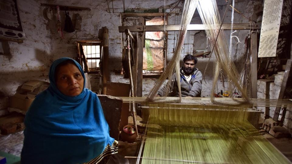 Master weaver Mohammad Sayeed with his wife Rukhsana, in his workshop. Meagre earnings have also deterred those engaged. A weaver's share is based on the price of product. Most weavers say they earn Rs 300-350 a day, but because the fabric length may take anything from 15 days to a month or more on the handloom, monthly incomes range around Rs 6000. (Raj K Raj / HT Photo)
