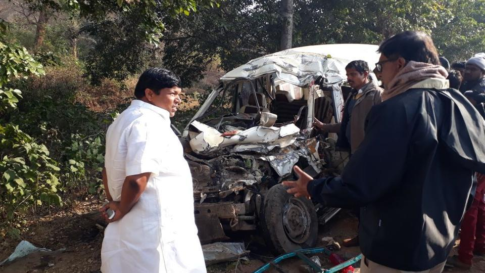 Locals near Dumka gather around the mangled remains of the SUVin which eight people killed.