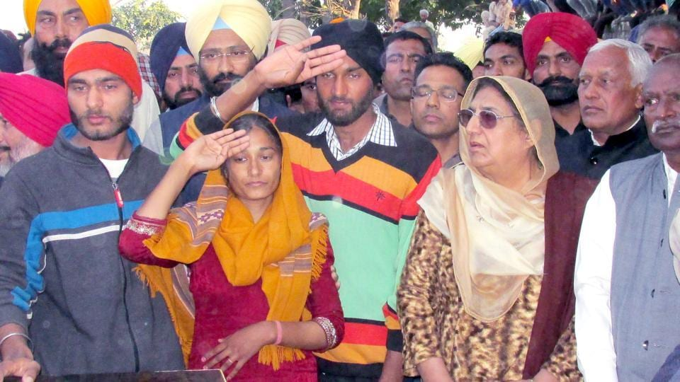 Family members of the sepoy giving their ward the last salute as his body arrived for cremation at his native village Alampur in Lehragaga tehsil of the district, on Sunday. Congress leader Rajinder Kaur Bhattal is also seen.