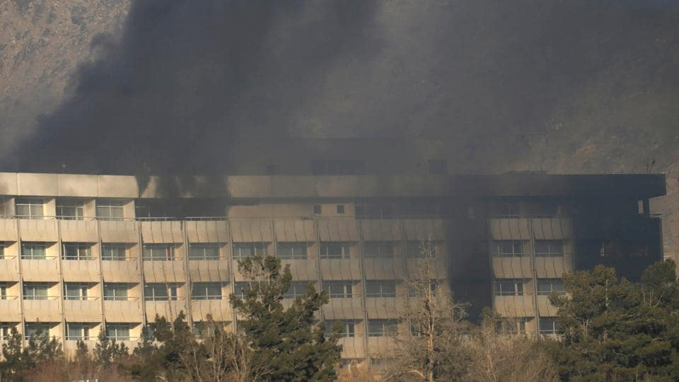 Smoke rises from the Intercontinental Hotel during an attack in Kabul, Sunday.