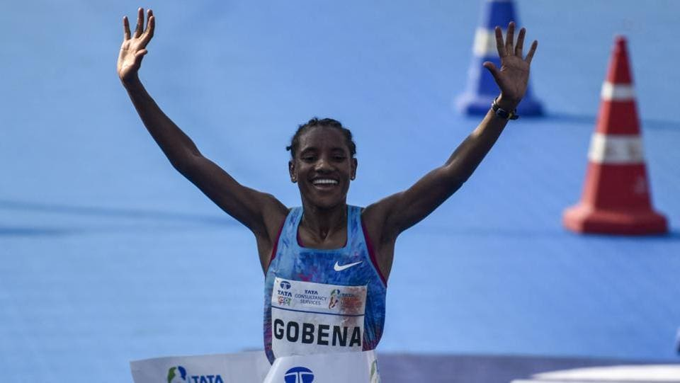 Ethiopia's Amane Gobena celebrates as she reaches the finish line. Solomon Deksisa and Amane Gobena made it a double delight for Ethiopia in this marathon by clinching the respective men's and women's races. (Kunal Patil / HT Photo)
