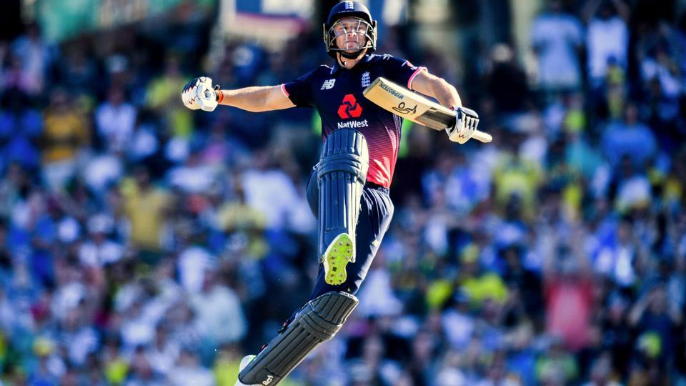 England's Jos Buttler celebrates after scoring a century during the one-day international match against Australia at the Sydney Cricket Ground in Sydney on January 21, 2018. England won the match by 16 runs to clinch their first-ever ODI series win in Australia.