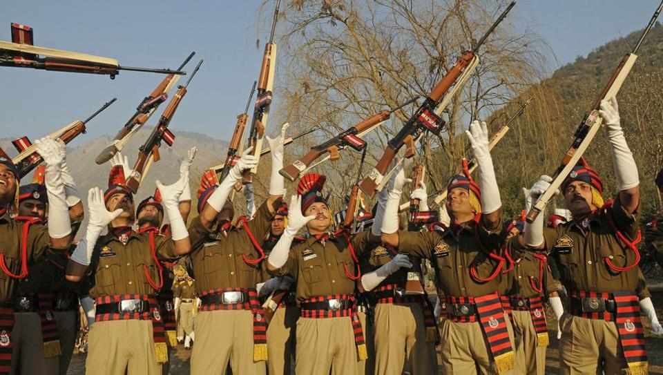 Fresh batch of Jammu and Kashmir police constables celebrate after their passing out parade in Baramulla district. (Waseem Andrabi /HT)
