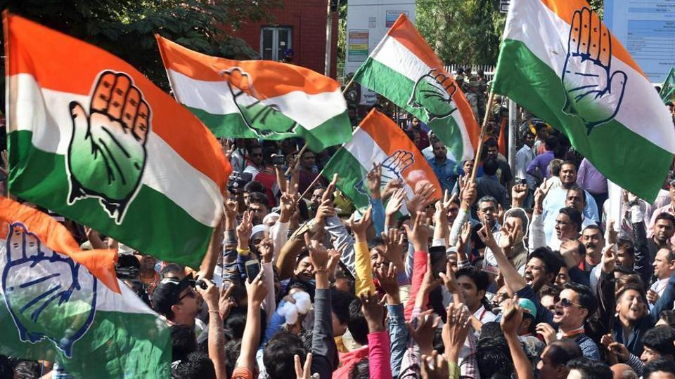 Ahmedabad: Congress party supporters celebrate after a party candidate's win in the Assembly elections, outside the Gujarat College counting centre in Amedabad on Monday. PTI Photo by Santosh Hirlekar (PTI12_18_2017_000076B)