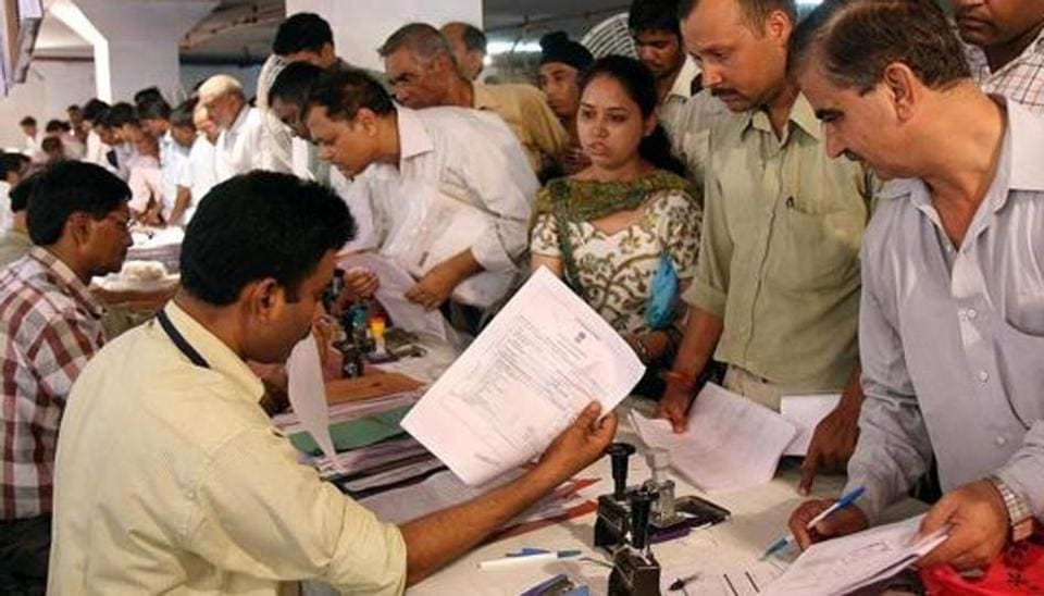 People Filing the Income Tax Return at Income Tax office Mayur Bhawan in the New Delhi.
