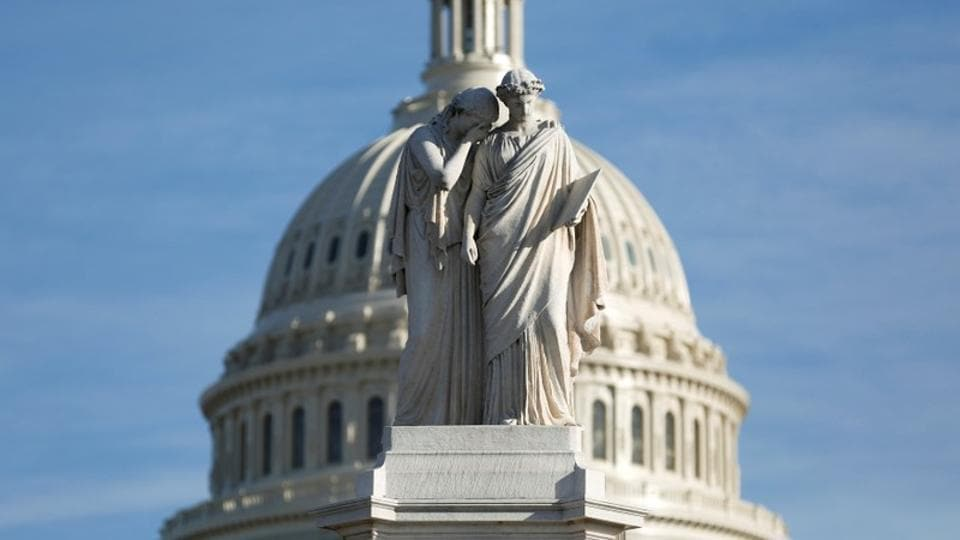 The figures of Grief and History stand on top of the Peace Statue near the US Capitol after President Donald Trump and the US Congress failed to reach a deal on funding for federal agencies in Washington, US.