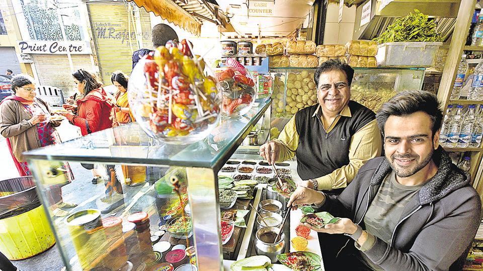 Yash Tekwani and his son Prateek at their shop in Greater Kailash on Tuesday.