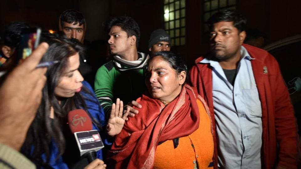 A TV news crew speaks to a woman at a hospital after a fire at a firecracker factory in north Delhi's Bawana Industrial Area on January 20 killed 17 people. (Sanchit Khanna/ HT Photo)