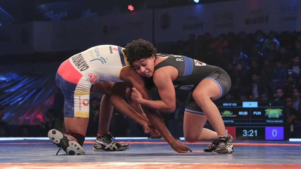 Punjab Royals' Pooja Dhanda (right) in action during her win against Odunayo Adekuoroye of Mumbai Maharathis in their Pro Wrestling League (PWL) tie at Siri Fort Stadium in New Delhi on Monday.