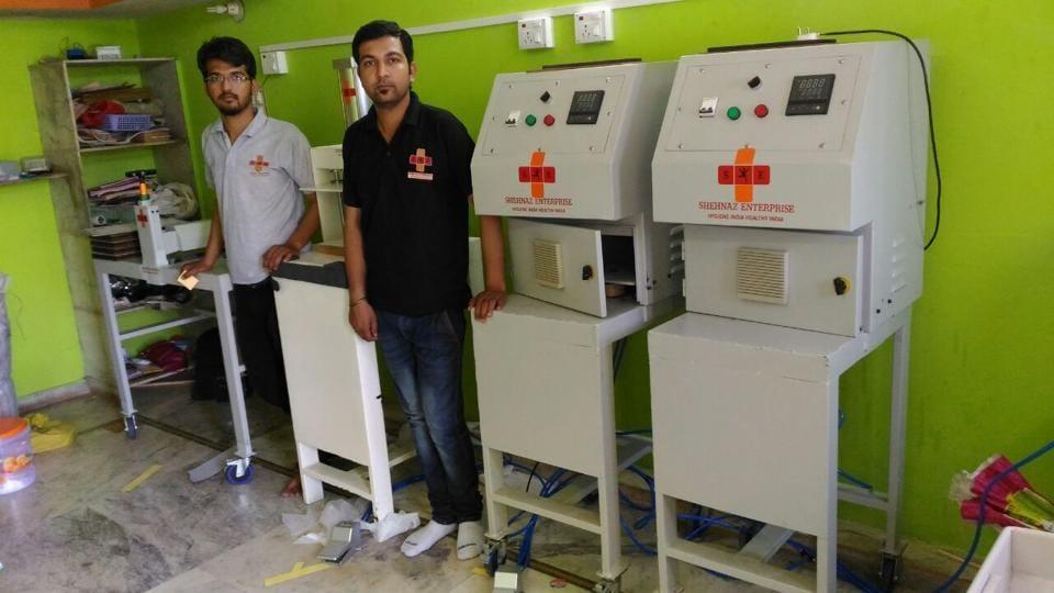 Rajasthan news,Udaipur brothers,sanitary pad-making machine