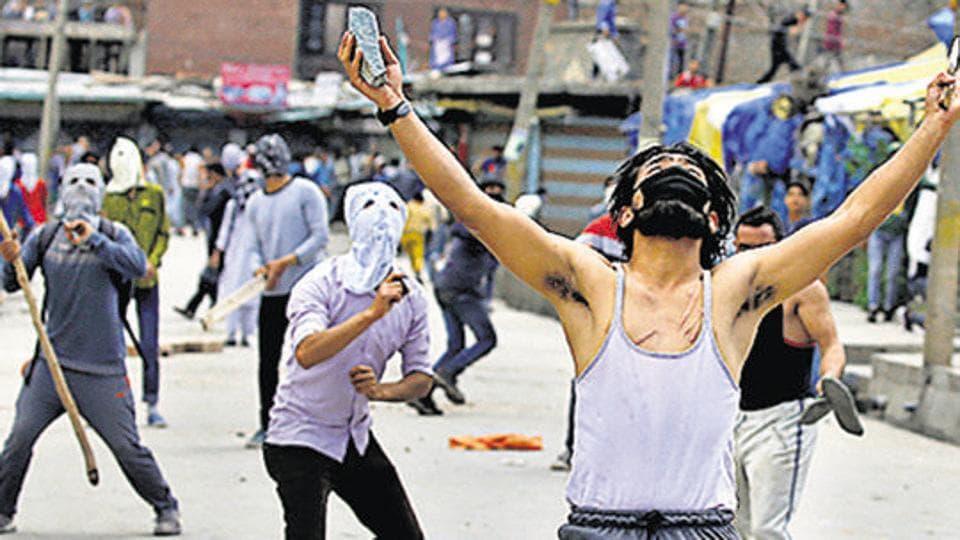Stone pelters clash with police in Srinagar, Kashmir.