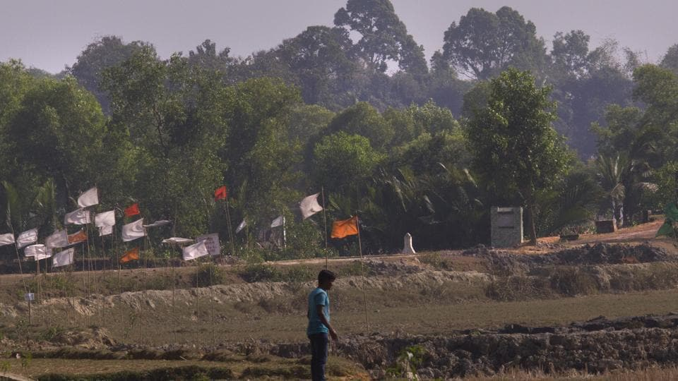 Flags are erected at a road construction site on the Bangladesh Myanmar border near Cox's Bazar, Bangladesh, Monday.
