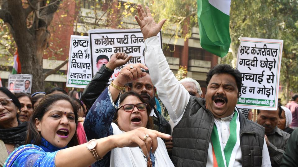 Congress workers demand the resignation of chief minister Arvind Kejriwal on corruption charges,  in New Delhi on Monday.