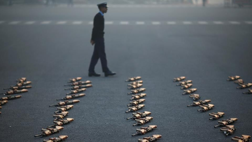 An Indian soldier stands guard next to rifles during a rehearsal for the Republic Day parade in New Delhi on January 22. (Adnan Abidi / REUTERS)