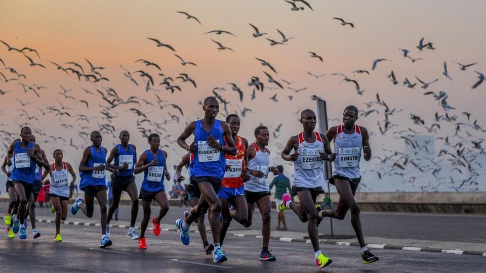 International participants seen along Marine Drive during the marathon. While the full marathon spanned a course of 42.1km, shorter half-marathons and special categories for senior citizens and differently-abled ensured greater participation than ever.  (Satyabrata Tripathy / HT Photo)