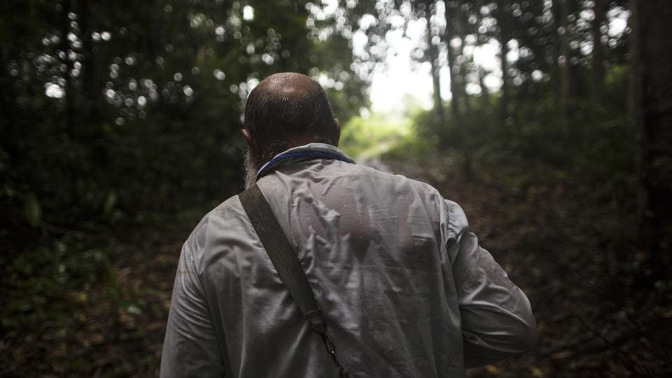 Pablo Zabala makes his way through the jungle under heavy rain to the rural home of a parishioner. After 10 years of service here, the Spanish priest has been transferred 130 kms (80 miles) away to Puerto Maldonado, known as the gateway to the Amazon jungle. (Rodrigo Abd / AP)