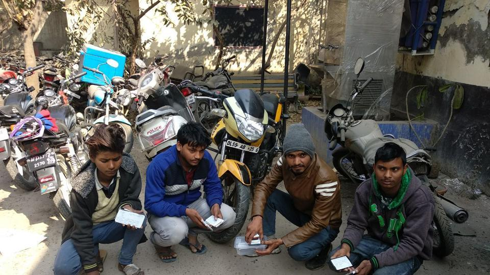 Noida police arrested four persons on Sunday night on charges of stealing 150-200 mobile phones.