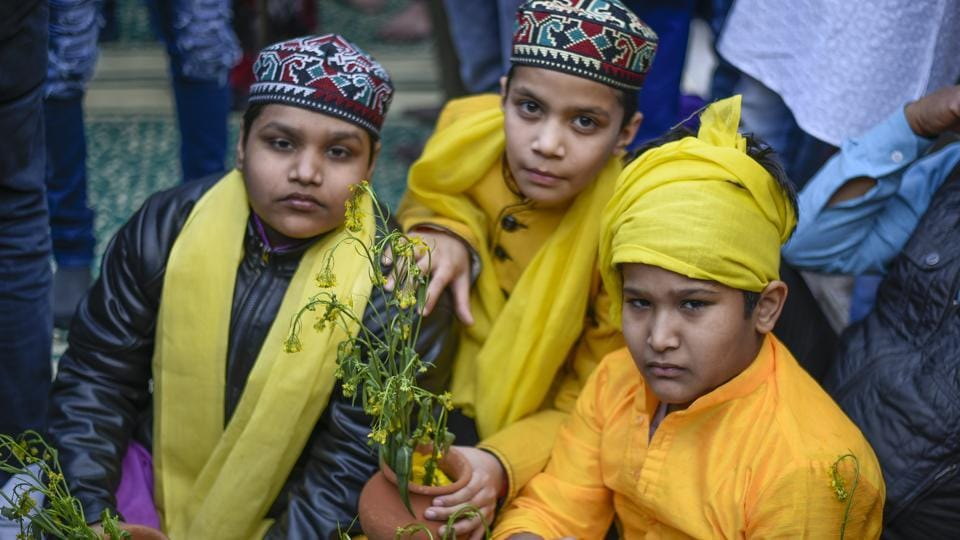 Every year as winter walks away to make space for Delhi's brief spring, people mark the shift of the season by offering yellow mustard flowers --or even yellow marigolds -- at the shrine of the aforementioned 14th century Sufi saint. Devotees come dressed in yellow to mark the day. (Burhaan Kinu / HT Photo)