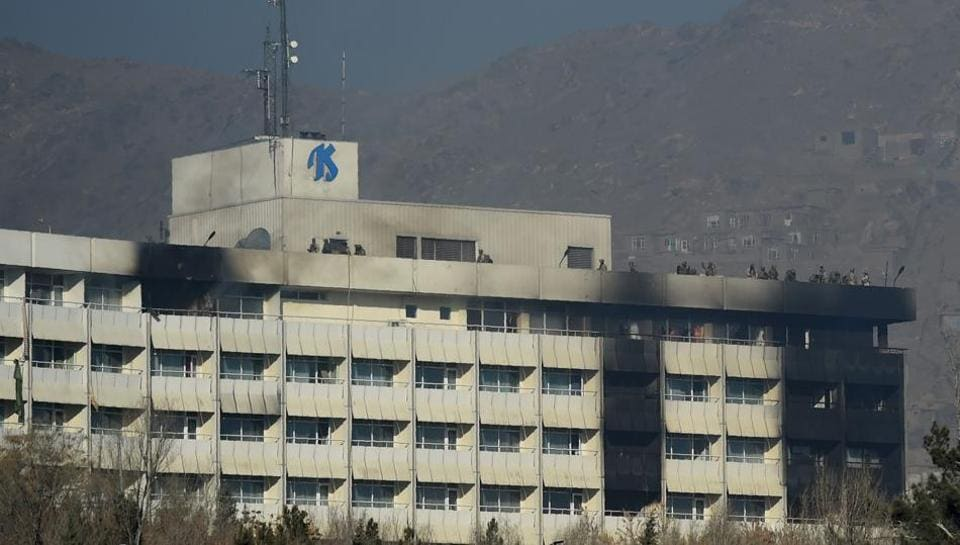Afghan security personnel take position at the rooftop of the Intercontinental Hotel during a fight between gunmen and Afghan security forces in Kabul on January 21, 2018.