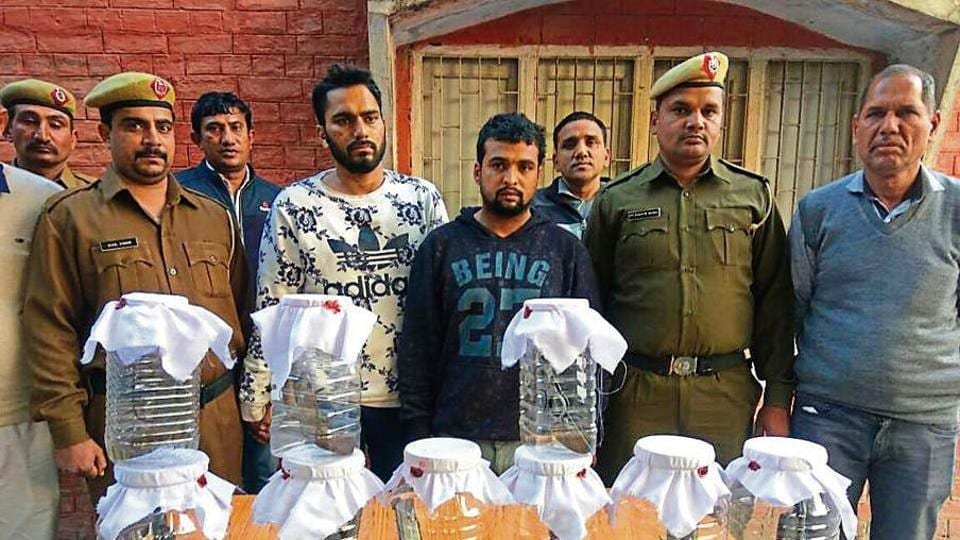 The two accused, third-year students of Jat college, Rohtak, in police custody on Monday.