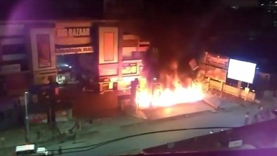 Protesters set fire to vehicles and property outside the Himalaya Mall in Ahmedabad on Tuesday.