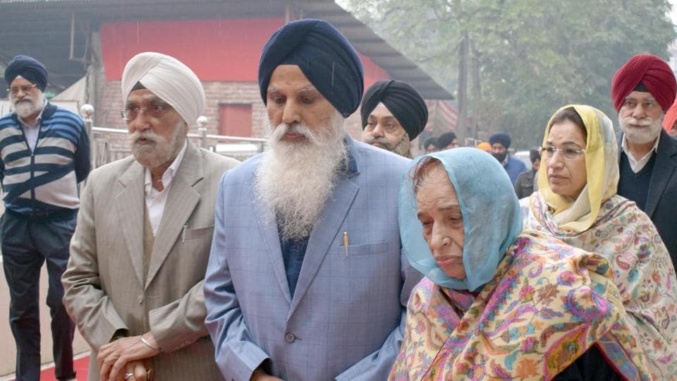 Former Chief Khalsa Diwan president Charanjit Singh Chadha (C) along with his family members on his way to appear before the  Akal Takht at Golden Temple in Amritsar on Tuesday.