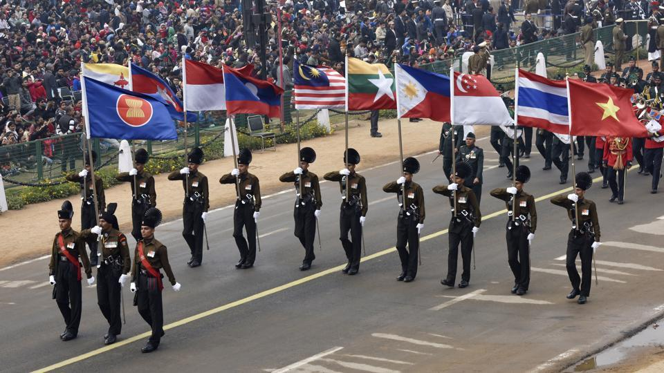 Army personnel bearing flags of ASEAN member nations during the rehearsal. Ten ASEAN heads of state will be in attendance as chief guests this year --a first in its own right --marking 25 years of India's association with the collective.  (Mohd Zakir / HT Photo)