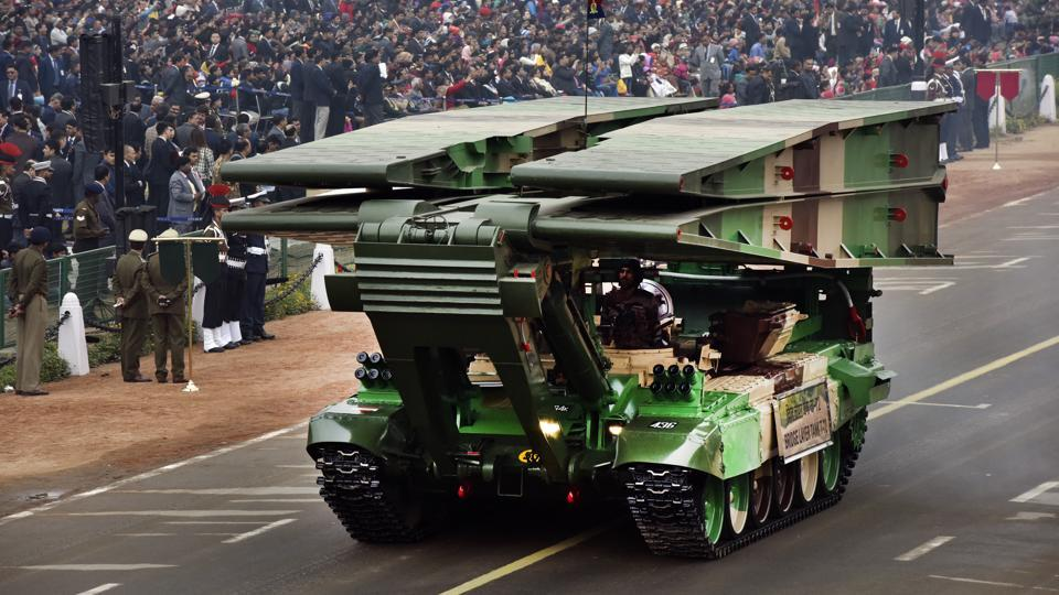 A Bridge Layer Tank T-72 ambles down Rajpath. The celebrations are also a projection of military might and feature appearances by missile batteries, heavy tanks, armament and ground technology displays. (Mohd Zakir / HT Photo)
