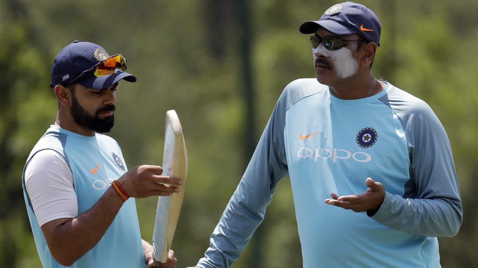 Virat Kohli, left, chats with coach Ravi Shastri ahead of India's third Test against South Africa in Johannesburg. (AP)