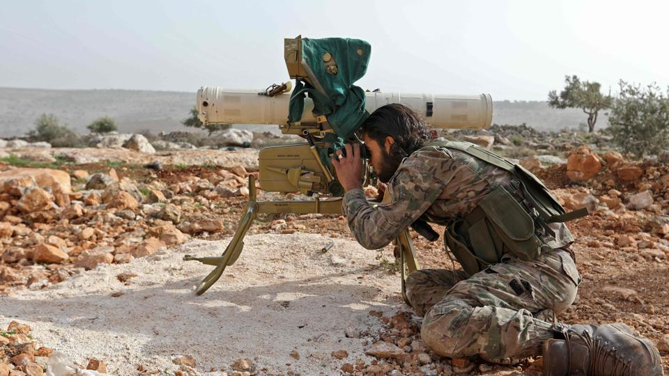 A Turkish-backed Syrian rebel fighter looks through the scope of a rocket launcher at a monitoring point near the Syrian village of Qilah, in Afrin region close to the border with Turkey.