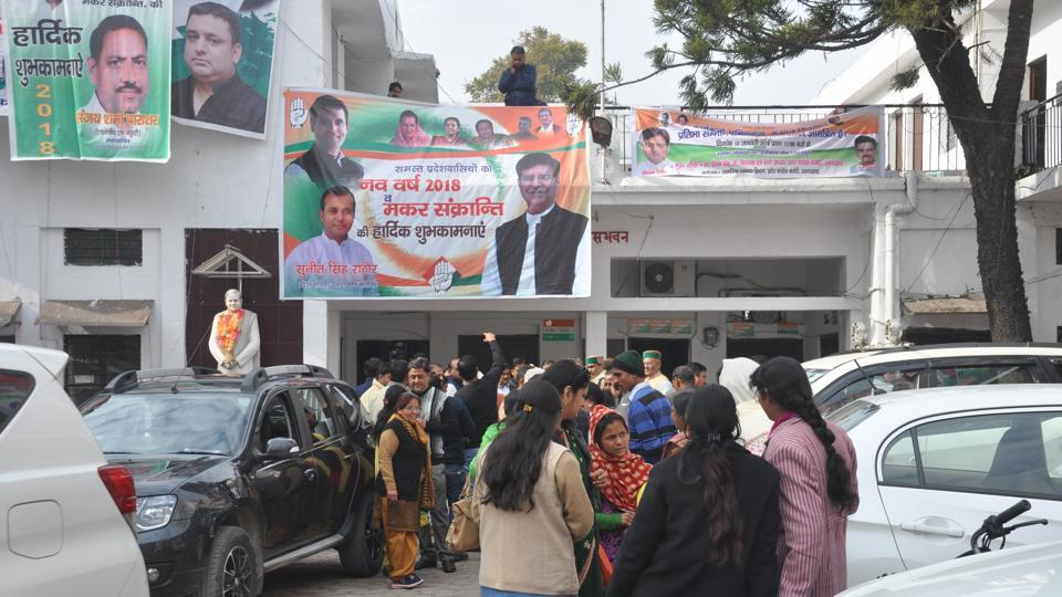 People outside Congress state headquarters in Dehradun.