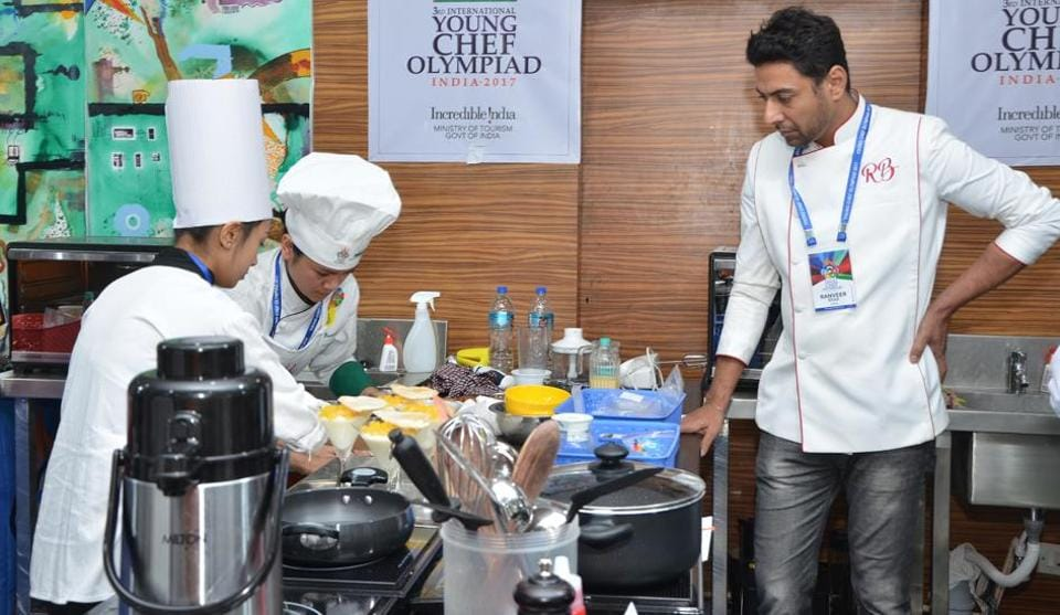 Chef Ranveer Brar supervises participants in the cooking competition's 2017 edition.