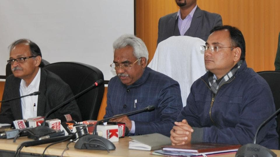 Minister Madan Kaushik (C) and CS Utpal Kumar (L) brief the media on cabinet decisions in Dehradun on Wednesday.