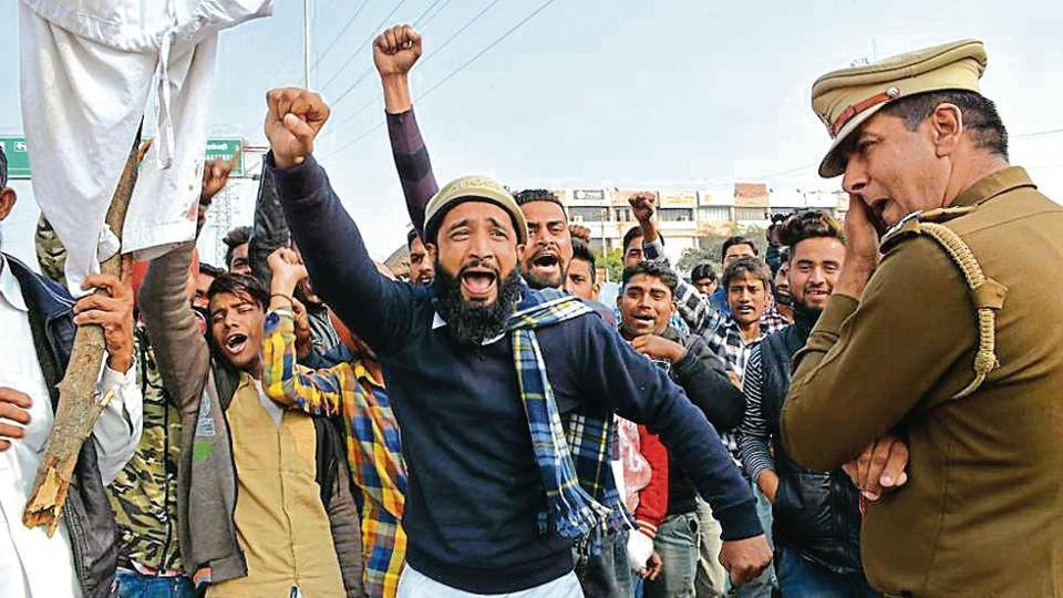 Kin of Ramzan Mohammad (right) blocking the Mansa Devi Complex road in Panchkula on Monday. They demanded the dismissal and arrest of the policemen whose brutality landed the 64-year-old in GMCH-32, Chandigarh, with severe injuries on the hip.