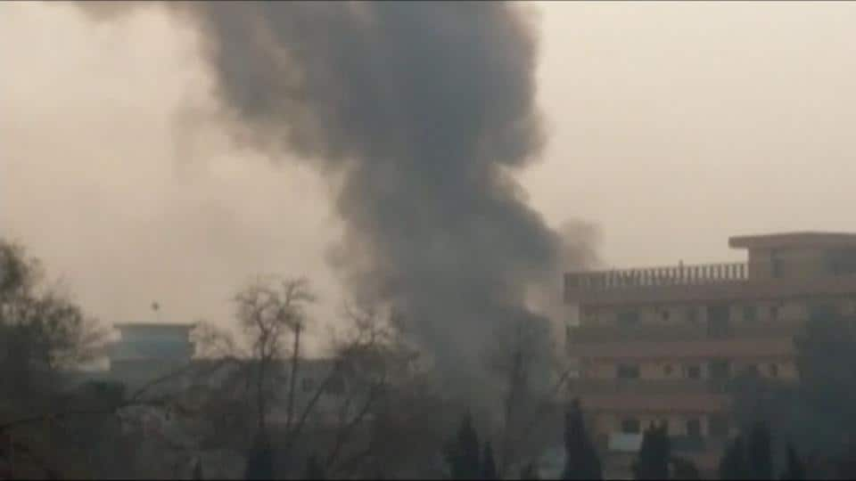 Smoke rises at the site of a blast near the office of the Save the Children aid agency in Jalalabad, Afghanistan, in this still image taken from Reuters TV footage, January 24, 2018.