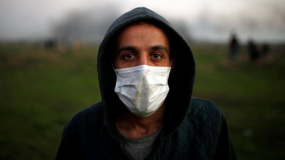"This protester wearing a medical mask said, ""The world must understand that unemployment is driving us all towards becoming fighters. We are not going to fight Hamas or Fatah, we will fight the Jews only."" The daily scene on the border shows, young Palestinians are increasingly put off by a four-year stalemate in peace talks, unemployment, lack of amenities, food and little progress towards healing internal rifts. (Mohammed Salem / REUTERS)"