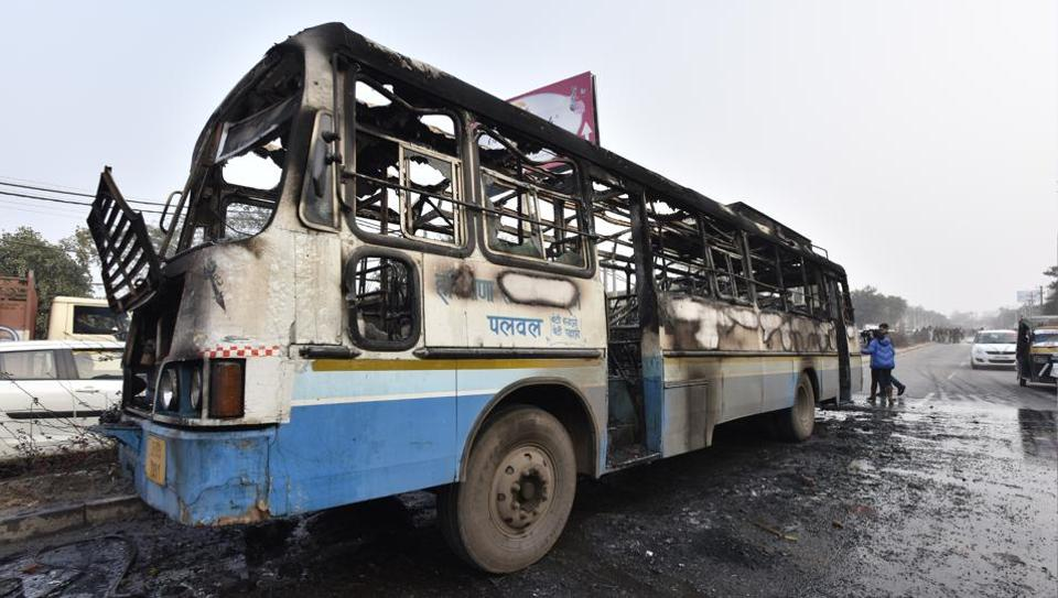 A Haryana Roadways bus was set on fire today near village Bhondsi in Gurgaon allegedly by activists of Karni Sena, who were protesting against the release of film 'Padmaavat'. Many instances of blockades and stone pelting were also reported from Gurgaon, Mathura and Meerut. (Sanjeev Verma/HT PHOTO)