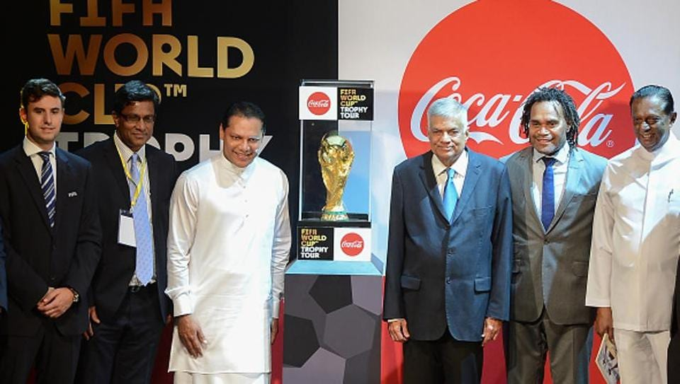Sri Lankan Prime Minister Ranil Wickremesinghe (3R), Sports Minister Dayasiri Jayasekara (3L) and French football player Christian Karembeu (2R), a 1998 FIFA World Cup champion, take part in a ceremony for the FIFA World Cup Trophy Tour in Colombo on January 24, 2018. The FIFA World Cup Trophy Tour is heading to 50 countries across six continents before returning to the host country in May, ahead of the 2018 FIFA World Cup in Russia.