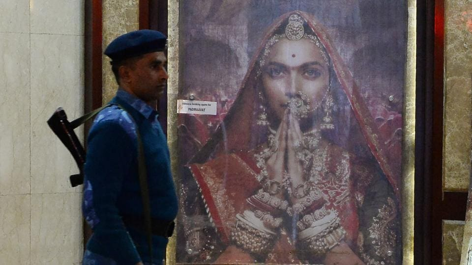 An Indian Rapid Action Force (RAF) personnel patrols a cinema hall scheduled to Padmaavat in New Delhi .